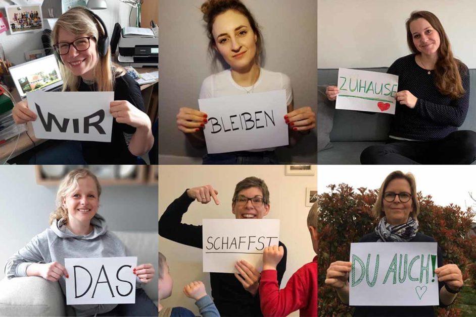 Sechs Frauen mit Schildern in der Schulschließung